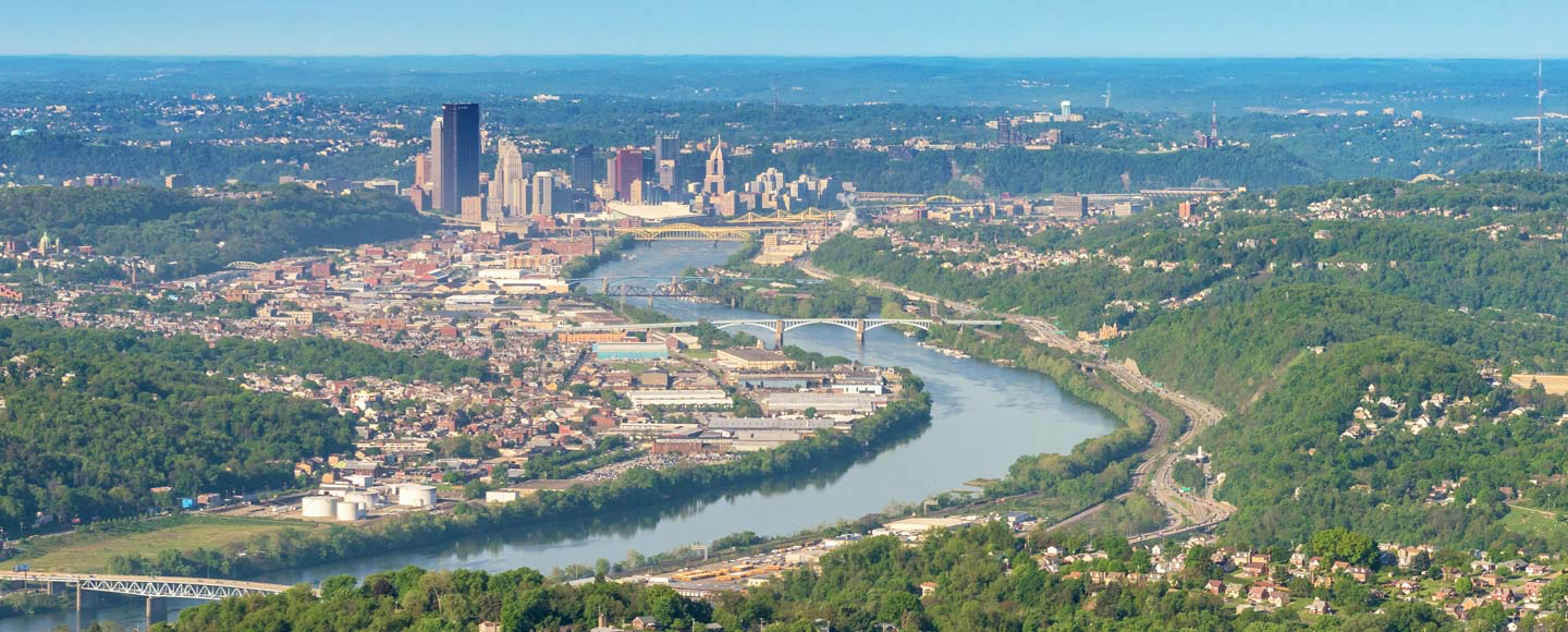 "{:alt=>""overhead shot of pittsburgh skyline and surrounding areas""}"