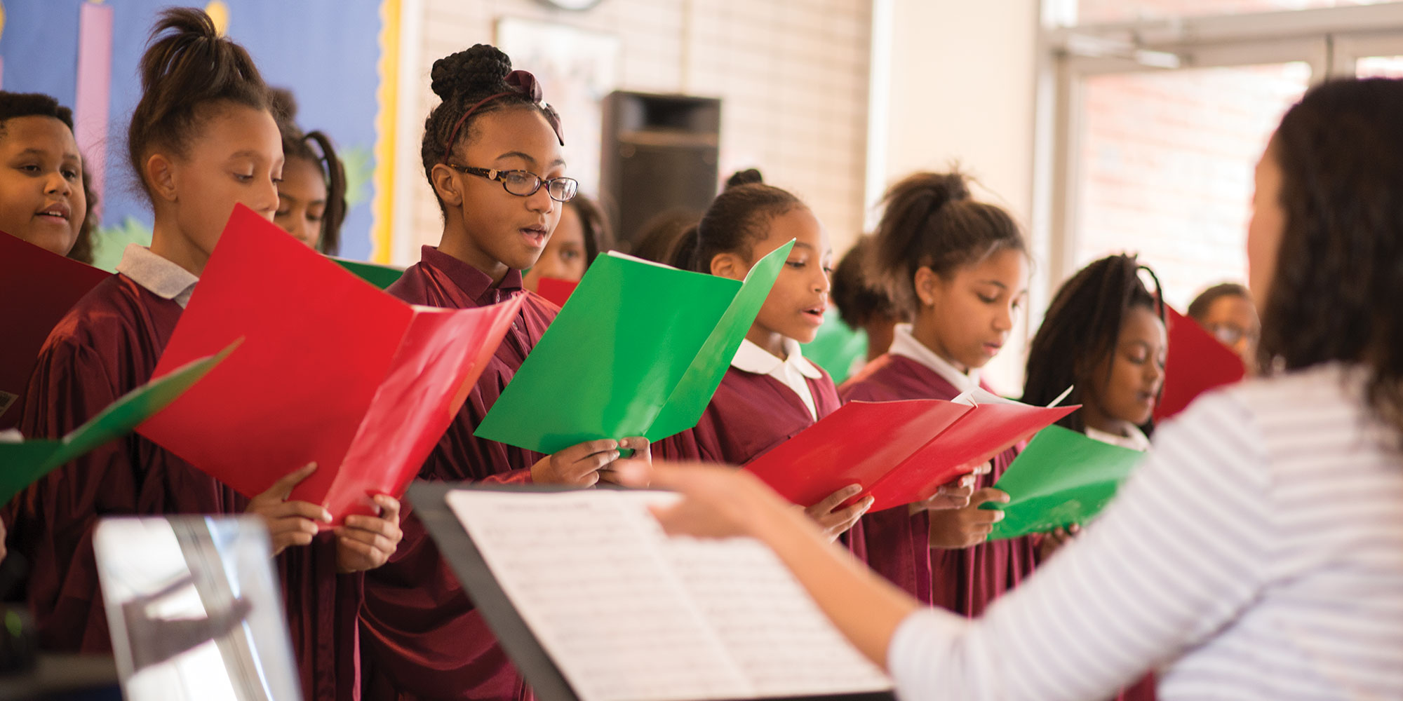 The Sister Thea Bowman Catholic Academy in Wilkinsburg educates children from pre-kindergarten through eighth grade. Here students perform for visitors to the school.