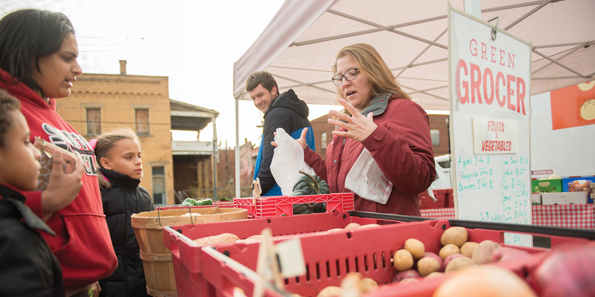The Green Grocer program, managed by the Greater Pittsburgh Community Food Bank, is a mobile farmers market designed to travel into food desert communities to provide fresh food options.