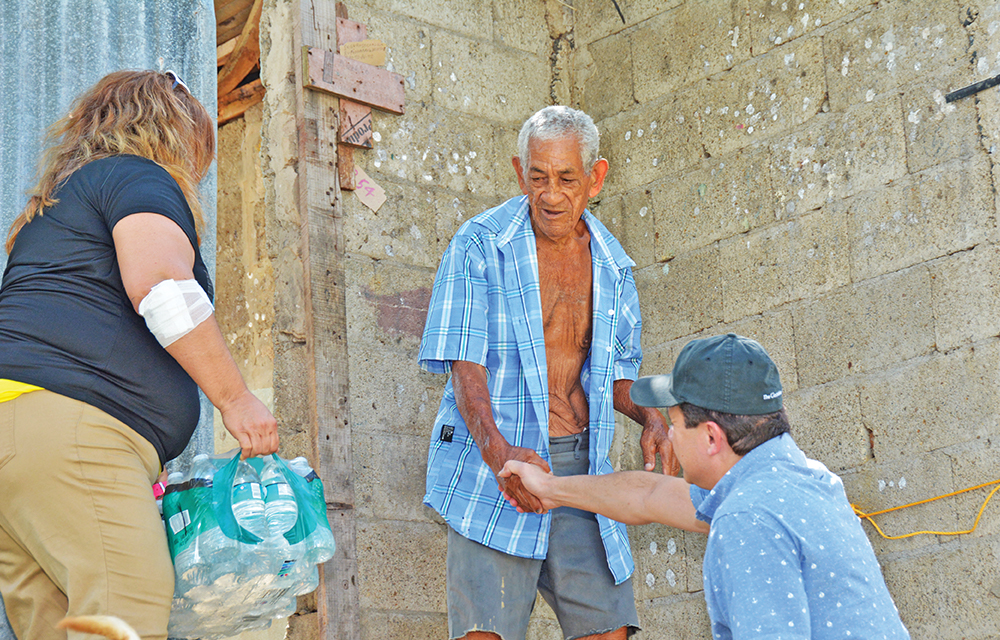 Volunteers distribute food, water, and medical supplies to residents in Puerto Rico whose homes and businesses were destroyed by Hurricane Maria.