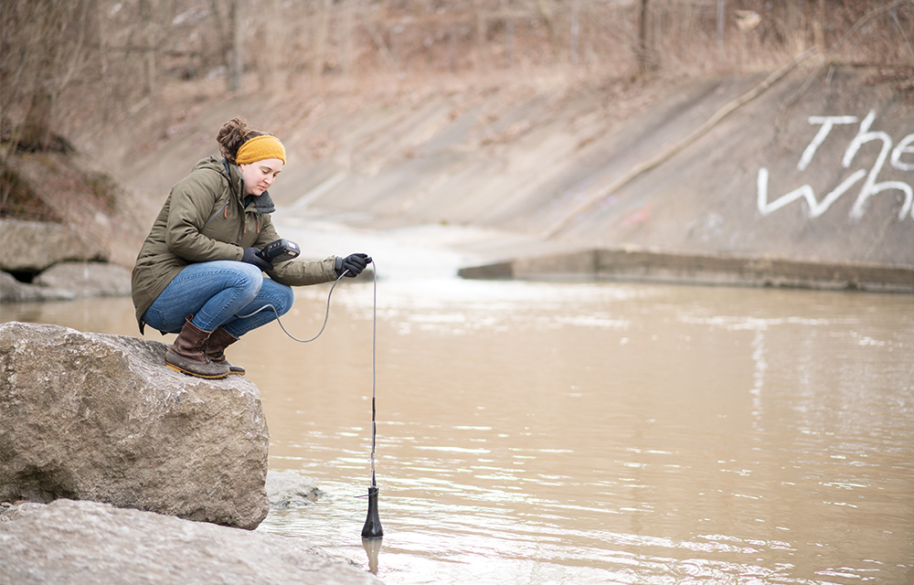 Nine Mile Run Watershed Association's Restoration Stewardship Coordinator carries out monthly water quality testing of the restored stream in Frick Park.